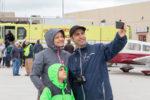 A local family enjoys the aviation expo at the 2017 YFC Runway Run